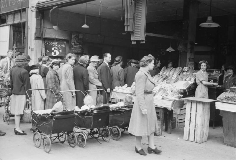 Old photo of people queuing for food
